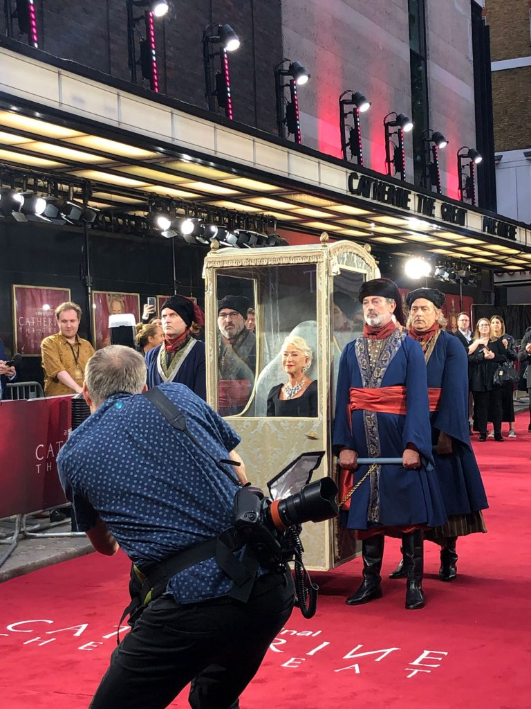 Helen Mirren arriving in the sedan chair prop